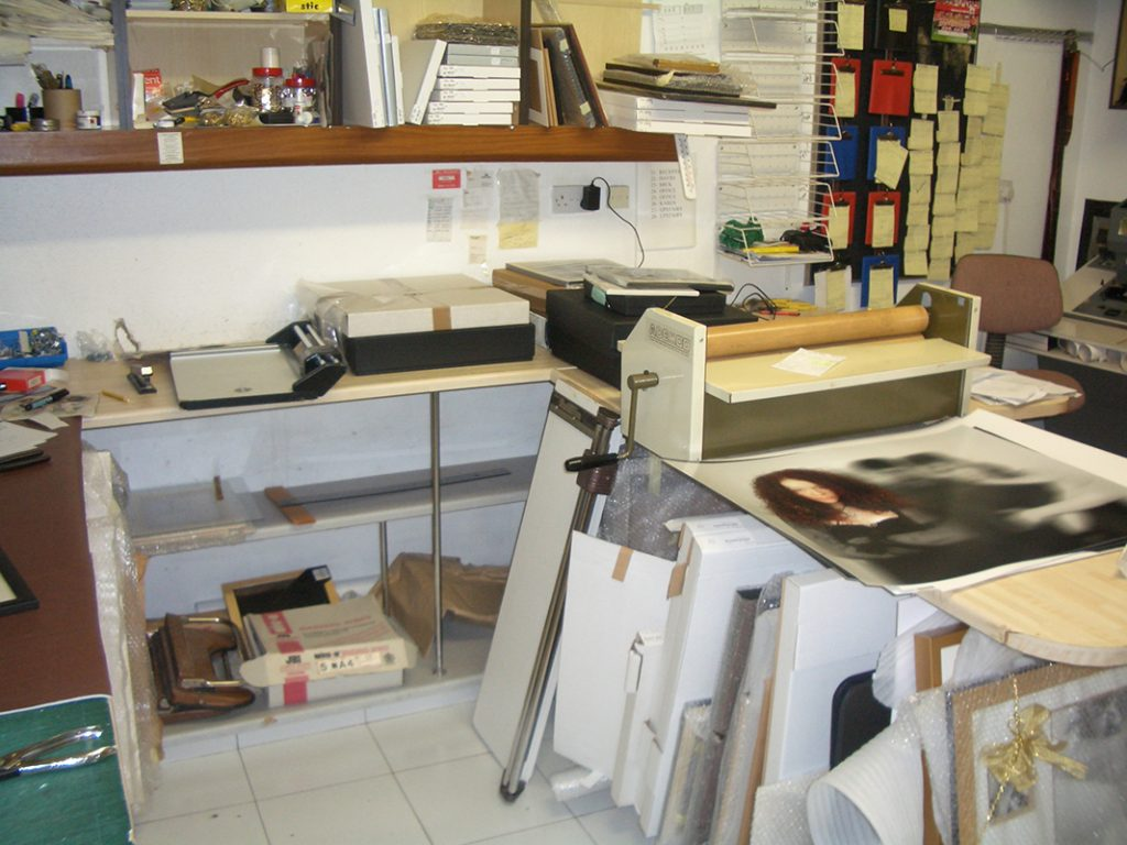 WE HAD OUR OWN MOUNTING PRESS WHERE EACH IMAGE WOULD BE MOUNTED ON BOARD